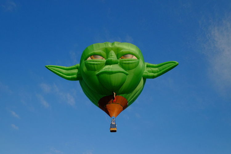 Flying Green Color Hot Air Balloon Outdoors Day Sky Clear Sky Mid-air Blue Flying High