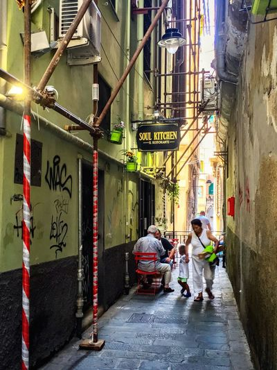 GLANCING THROUGH ALLEYS Architecture Built Structure Real People Building Exterior Full Length City The Street Photographer - 2018 EyeEm Awards Men Women Walking Rear View Direction Adult Street Transportation Outdoors Building People The Way Forward Text Day Streetwise Photography
