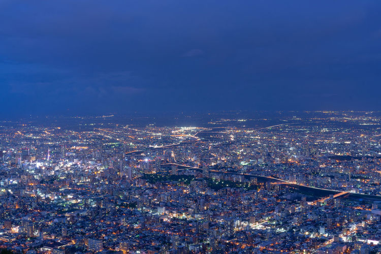 Hokkaido Japan Aerial View Architecture Blue Building Building Exterior Built Structure City City Life Cityscape Cloud - Sky Crowd Crowded High Angle View Illuminated Nature Night Office Building Exterior Outdoors Pollution Sapporo Sky Skyscraper Travel Destinations
