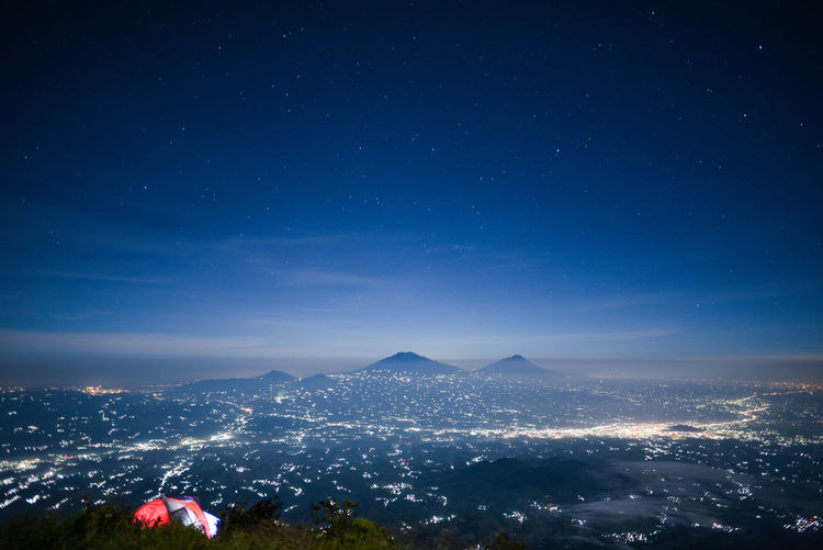 Night on Sumbing Mountain Nightphotography Mountain Sky Night Scenics - Nature Beauty In Nature Mountain Range Nature Illuminated No People Star - Space Blue Tranquil Scene City Cityscape Tranquility Architecture Building Exterior Outdoors Landscape Environment Mountain Peak