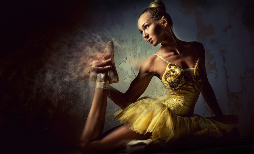 Digital Composite Image Of Ballet Dancer Stretching By Wall