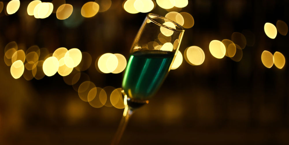 White drink on bokeh background. Night Lighting Equipment Focus On Foreground Close-up No People Decoration Glass Drink Defocused Glass - Material Multi Colored Food And Drink Light Beverages Alcoholic  Cocktail Backgrounds Nightlife Party Liquid Shot Wine Bokeh Blur Blue