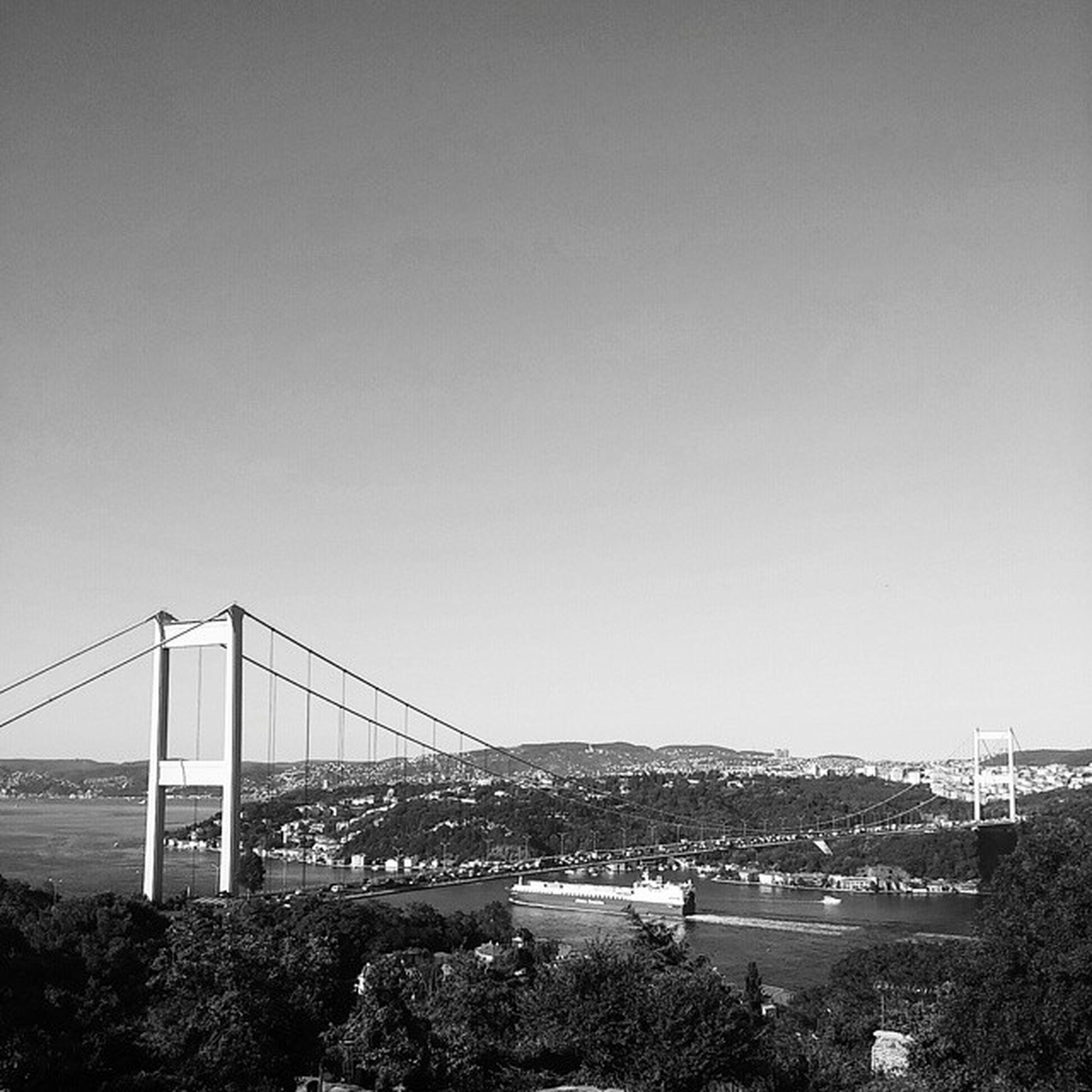 built structure, architecture, connection, bridge - man made structure, clear sky, copy space, engineering, suspension bridge, transportation, water, bridge, river, sea, building exterior, travel destinations, city, outdoors, travel, day, no people