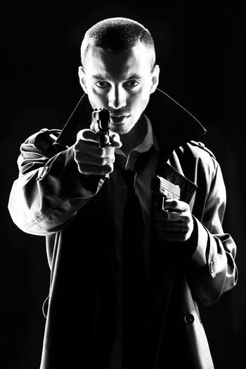Franklin Miller's Sin City. Studio portrait in low key with high contrast. Cosplay comic book characters. Black and white photography. The shooter prepares to attack Black & White Black Background Low Key Sin City Adult Adults Only Black And White Black Background Black&white Blackandwhite Blackandwhite Photography Contrast Danger Dangerous Front View Gunslinger  High Contrast Holding One Person People Portrait Standing Studio Shot Waist Up Young Adult