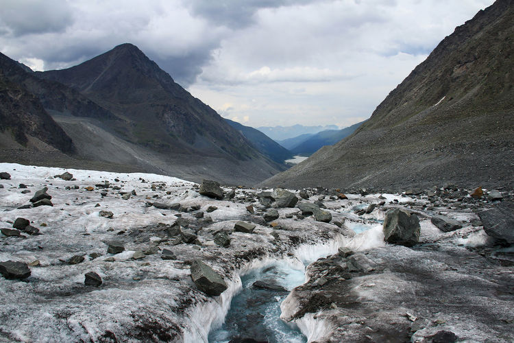 View from the glacier to the mountain valley in altai in cloudy weather, the sky with clouds