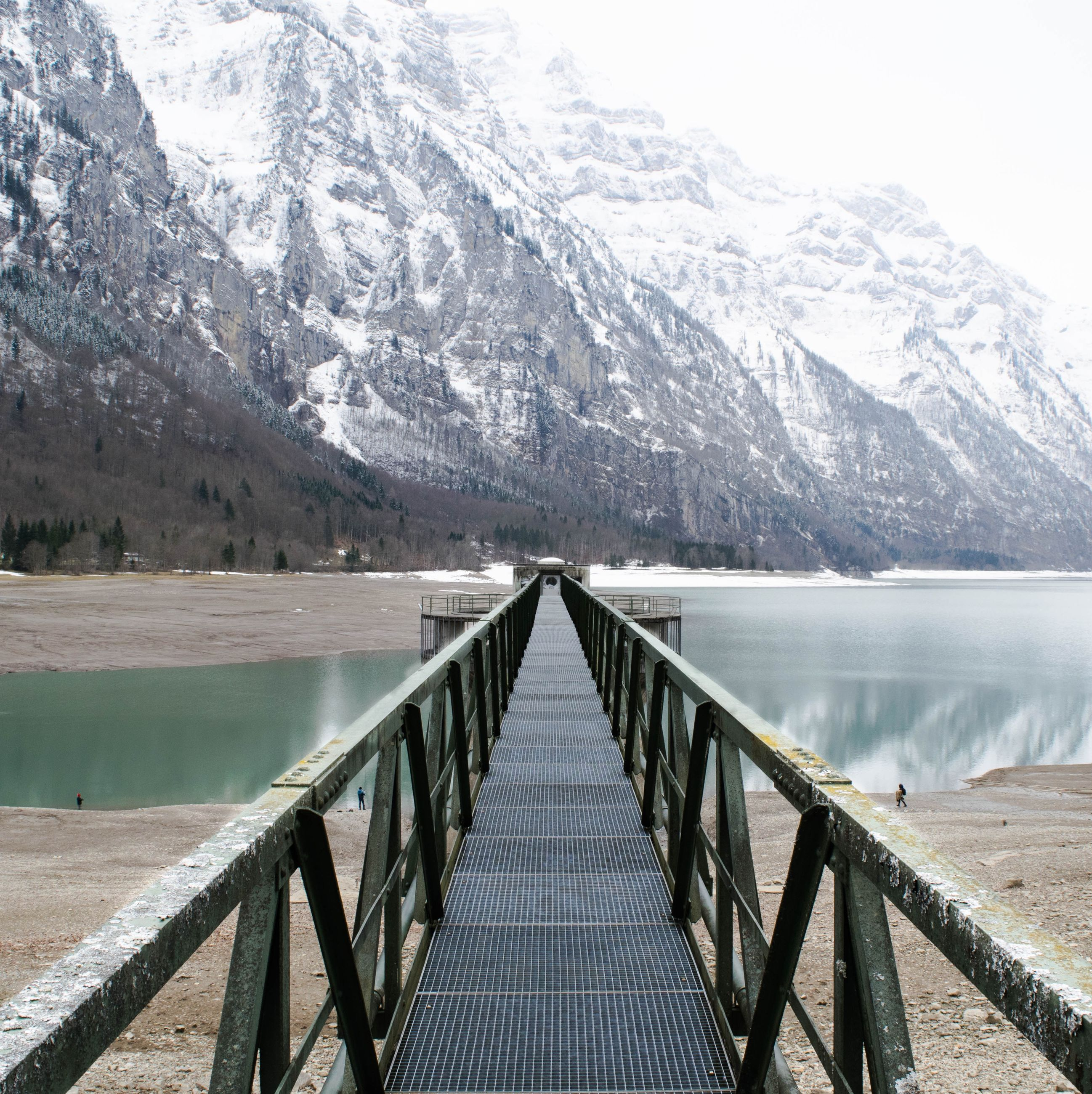 mountain, water, the way forward, railing, diminishing perspective, mountain range, tranquil scene, tranquility, scenics, winter, lake, beauty in nature, sky, cold temperature, nature, snow, vanishing point, river, built structure, season