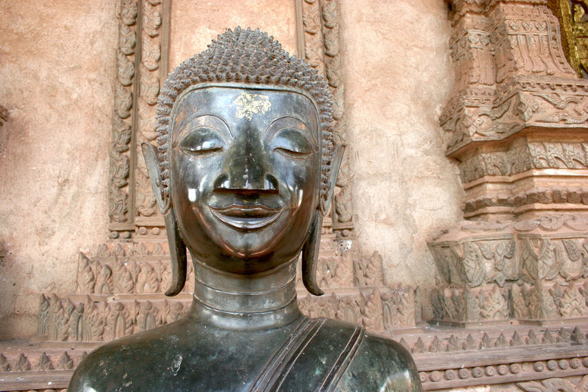 Smiling Buddah statue. Vientiane, Laos. Vientiane, Laos Ancient Architecture Close-up Day Face No People Outdoors Religion Sculpture Smile Spirituality Statue Travel Destinations