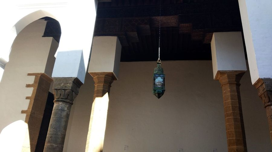 Low angle view of hanging outside building