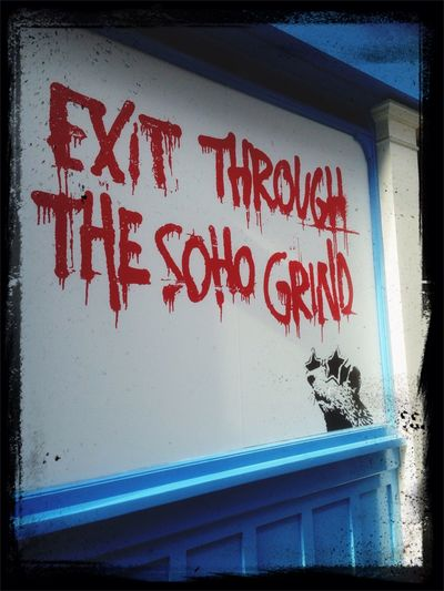 """A coffee shop 'Soho Grind' in Beak Street in iconic Carnaby area located between Oxford Circus and Piccadilly Circus of the London West End will open soon for business. Its owners, in my viewpoint, have already got people interested by displaying a huge Banksy-esque graffito-style board playing, again, on Banksy's """"Exit Through The Gift Shop"""" movie name. I wonder whether they paid him or he knows about it at all!!"""