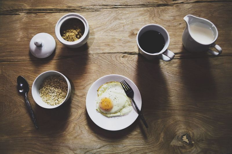 Old fashioned country breakfast flatlay. 🍳 Coffee Cup Food And Drink Table Coffee - Drink Freshness High Angle View Food Drink Breakfast Indoors  Ready-to-eat Refreshment Plate Healthy Eating Sunny Side Up Eggs Breakfast Flatlay Cup Of Coffee Bowl Of Oatmeal Oatmeal Flatlay Egg Eggs And Coffee Oatmeal And Coffee Healthy Breakfast