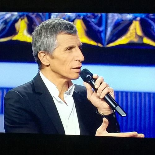 """Watching """"N'oubliez pas les paroles"""" (""""Do not forget the lyrics"""") with Nagui, the funniest and most irreverent TV host in France. Nagui Noplp Television"""