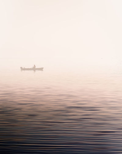 Beauty In Nature Nature Nautical Vessel Minimal Rowing Scenics Sea Sunset Water Waterfront Boat Fisherman Fog Landscape Nature Photography Nature_collection Evening Light Evening Glow Foggy Misty Lonely Scenic Gentle Calm Long Goodbye Bodensee BYOPaper! The Great Outdoors - 2017 EyeEm Awards EyeEm Selects Breathing Space Lost In The Landscape Lost In The Landscape Shades Of Winter