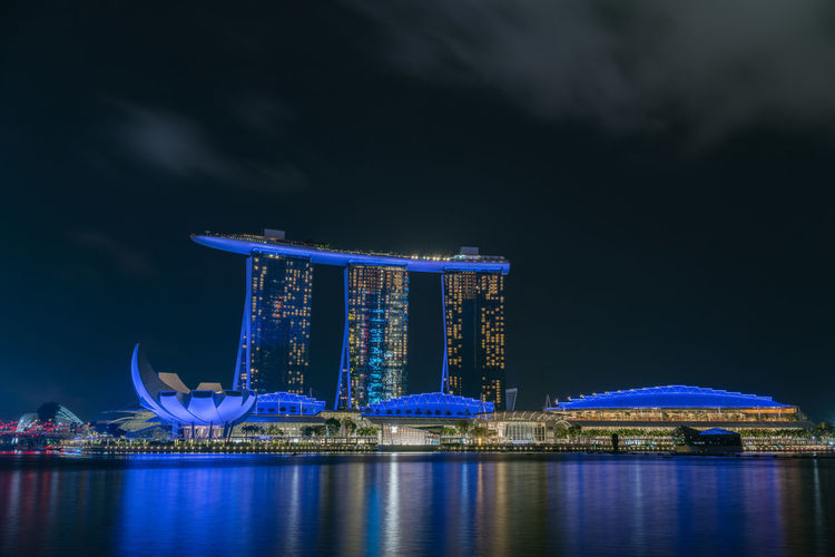 Beautiful night skyline at marina bay waterfront, Marina Bay Sands Hotel and Art Science Museum in Singapore ASIA Architecture Asian  Beautiful Business Casino Central Park Harbor Luxury Hotel Marina Marina Bay Sands Marina Bay Sands Hotel Marina Bay Singapore Modern Skyline Travel Building Built Structure Citiscape  District Downtown District Illuminated Landmark Luxury Night