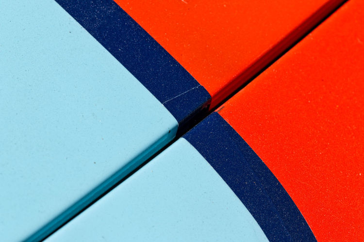 bonnet - hood of sports car Automobile Backgrounds Blue Bonnet Car Close-up Day Full Frame Geometric Shape High Angle View Hood Multi Colored No People Orange Color Pattern Red Shape Sports Car Sportscar Still Life White Color 17.62°