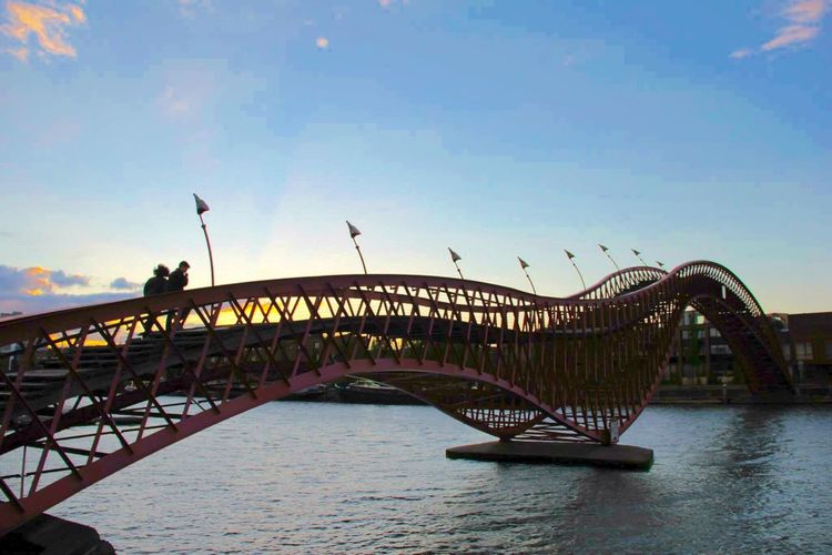 Your Amsterdam Bridge City In The Evening Evening Bridge Collection Bridges_aroundtheworld Bridge Construction Architecture Architecture_collection Architecturelovers Python Bridge Springtime Telling Stories Differently Up Close Street Photography