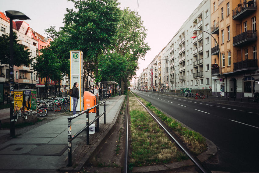 Late evening traffic City City Life City Street Perspective Public Transportation The Street Photographer - 2018 EyeEm Awards Tram Urban Lifestyle Urban Perspectives Urban Geometry Waiting Berliner Ansichten City View  Daylight Evening Mode Of Transport People Platform Point Of View Residential District Stop Street Streetphotography Urban Waiting For A Train