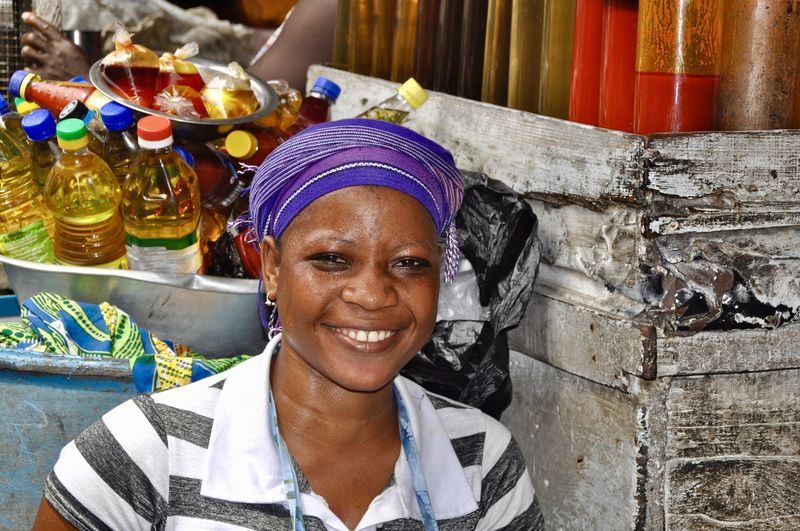 African Faces Of Africa Ghana Makola Market Market Vendor Portrait Of A Woman Woman Power Africa African Beauty Emotion Front View Happiness Headshot Laughing Faces Lifestyles Looking At Camera One Person Portrait Real People Selling On The Street Small Business Smiling Teeth Toothy Smile Women Food And Drink Working Adult Females