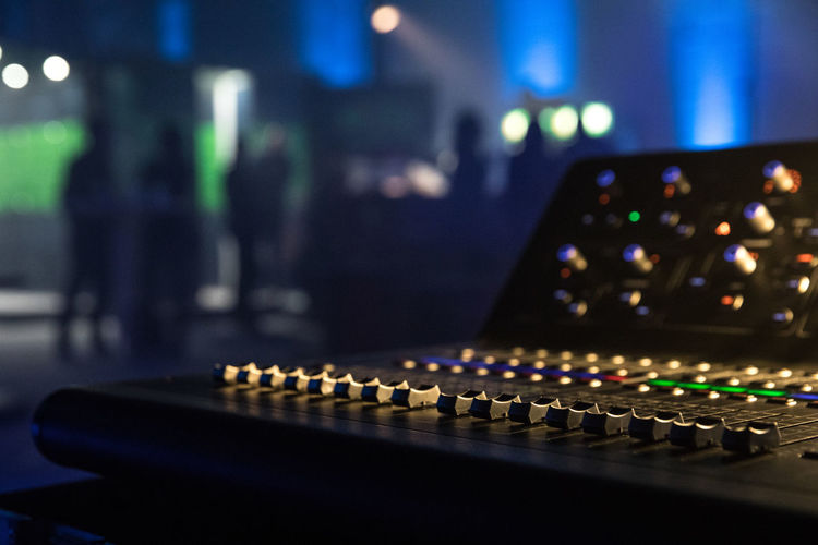 Cropped image of sound mixer in nightclub