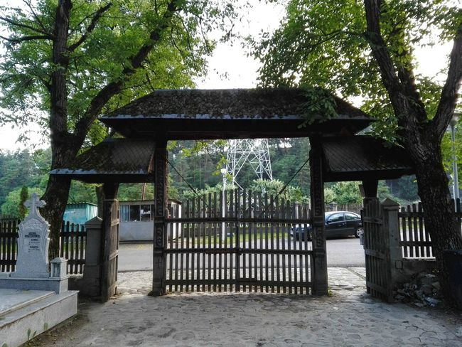 An old tradtional Romanian wood gate, this one is the cimitery gate at monestery Bistrita, near Piatra Neamt, Romania. Absence Architecture Built Structure Cimetary Closed Day Empty Growth Nature No People Old Gate Outdoors Plant Romanian Gate Sky Sunlight Traditional Romanian Gate Tranquility Tree Wood - Material Wood Gate
