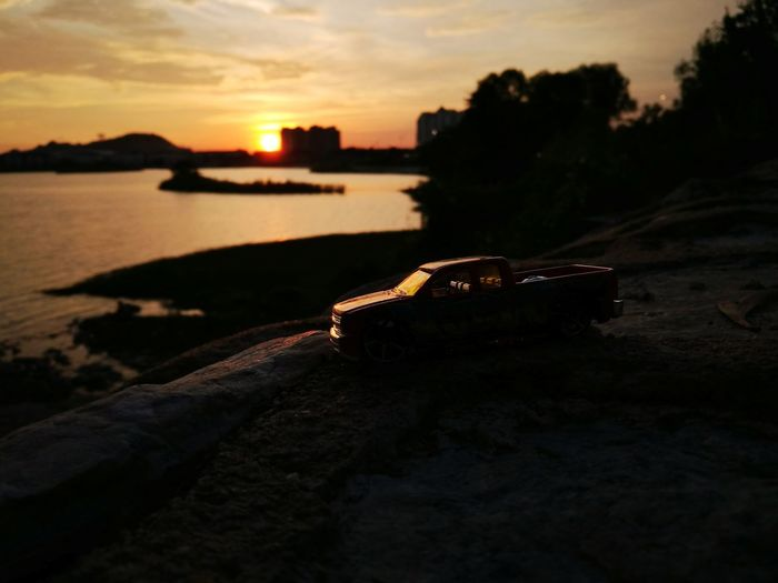 Low Tide Beauty In Nature Sky Illuminated Nature Outdoors Sunset No People Reflection Water Dusk Toys Hardtoys
