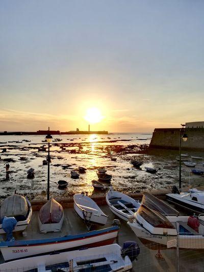 THE SUN IS MY LIGHTHOUSE Cádiz, Spain Caleta Water Nautical Vessel Sea Sunset Beach Sunlight Moored Sky Horizon Over Water