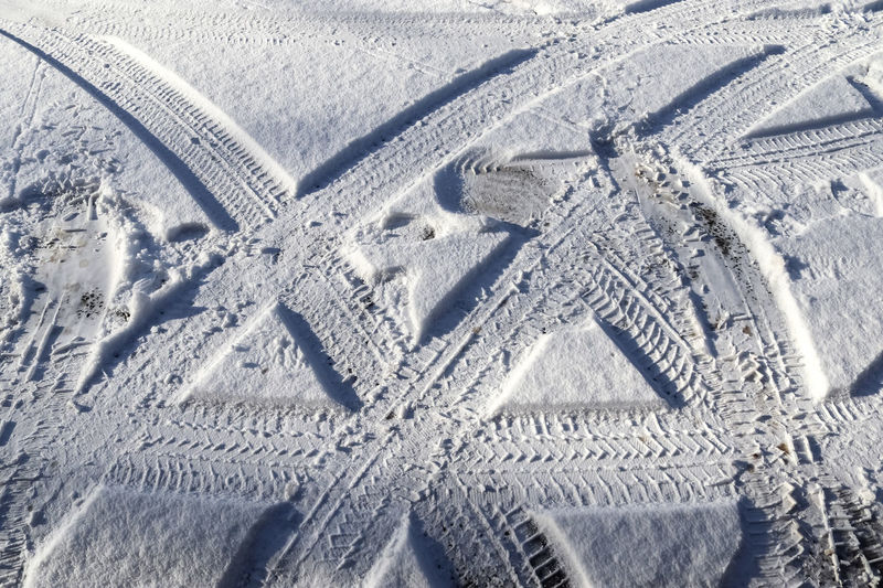 High angle view of tire tracks on snow