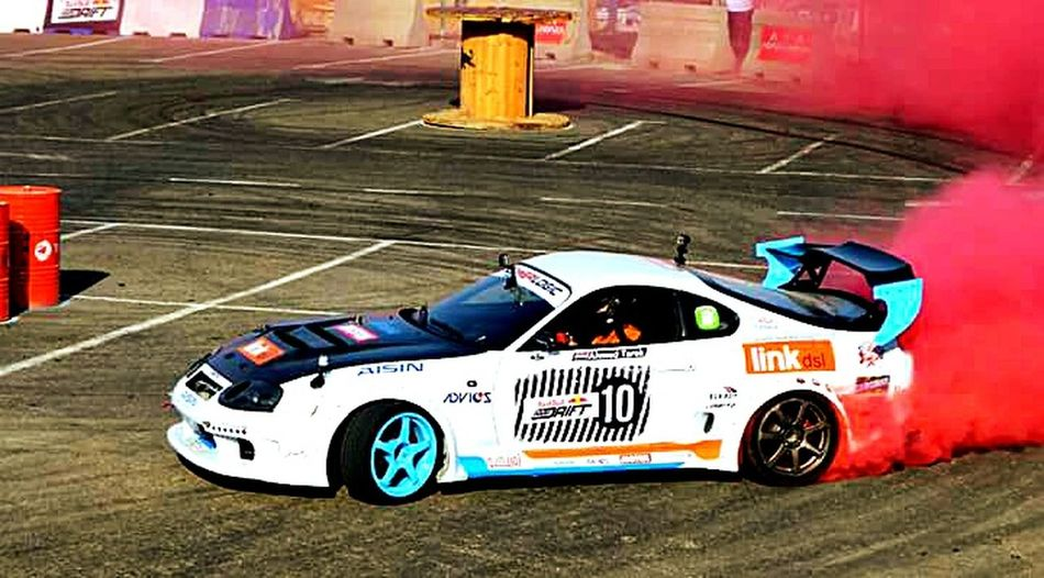 Car Transportation Mode Of Transport Driving Racecar Asphalt Adults Only Adult Day Outdoors Toyota Supra  Drift Cars Race Car RedBull Red Smoke Toyota Supra  Toyota Motor Sports Drift Cars Drifthard
