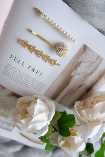 High angle view of white roses on table