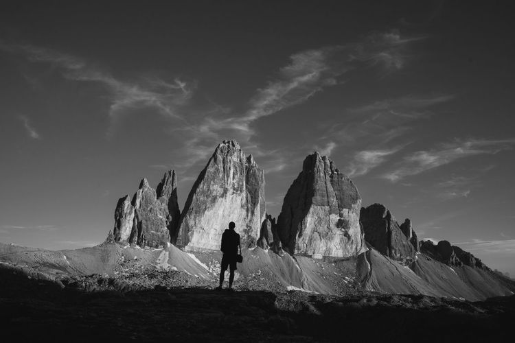 Silhouette of a man against mountains