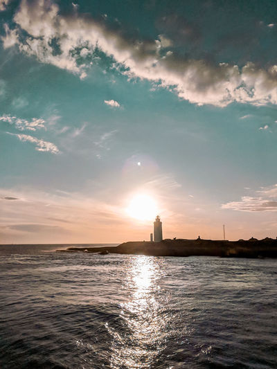 Sunset and lighthouse. Tarifa Tarifa Spain Evening Sky Evening Arrival Ferry Views Water Sea Sunset Beauty Summer Blue Water's Edge Awe Lighthouse Romantic Sky Atmospheric Mood Moody Sky Coast Atmosphere View Into Land Groyne Silhouette Dramatic Sky Calm Cloudscape