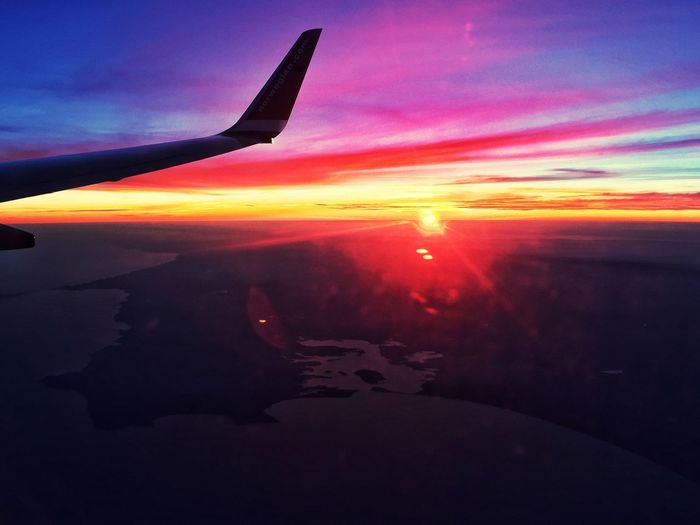 Soaring at sunset Sunset Airplane Sky Beauty In Nature Aerial View
