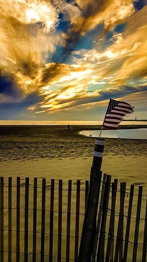 America Americathebeautiful  American Flag Check This Out Taking Photos Sunset Sunsetbeach Capemay Blowing In The Wind... Clouds And Sky Sky_collection Neverstopshooting Eyeemphotography Eyemnaturelover Beautiful Point Of View Feel The Journey