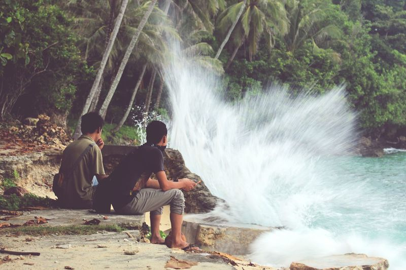 Lost In The Landscape Water Outdoors Beach Beauty In Nature Nature Waterfall Men People Motion Togetherness Sitting Day Adult Only Men Adults Only