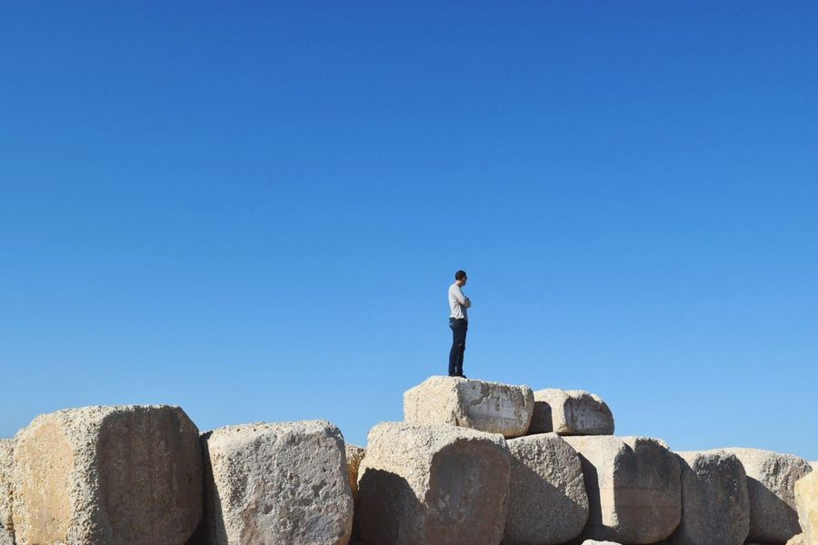 Copy Space Clear Sky Blue One Person Real People Repetition Shapes And Forms Shape Geometric Shape Tel Aviv Adult Standing Leisure Activity Nature Finding New Frontiers Rock - Object Low Angle View Men Sky Beauty In Nature Israel Minimalism Rocky Stone Material Only Men