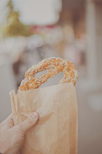 Brezel Pretzel Human Hand Human Body Part Hand One Person Food And Drink Holding Food Focus On Foreground Sweet Food Dessert Indulgence Sweet Unrecognizable Person Freshness Unhealthy Eating Real People Ready-to-eat Close-up Human Finger Finger