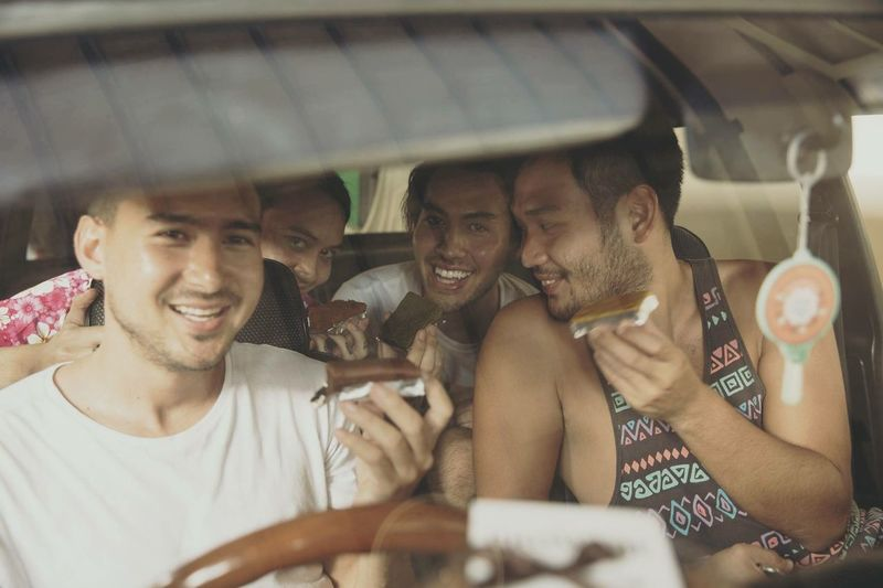Riding in cars with brownies Group Of People Mode Of Transportation Smiling Men Transportation Adult Friendship Young Adult Fun Happiness Young Men Travel Emotion Togetherness People Car Motor Vehicle