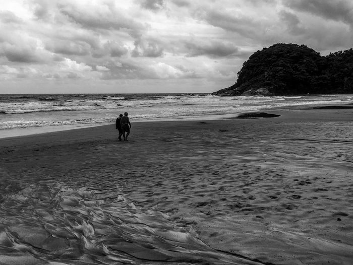 Keeping Walking .. Sea Beach Sand Sky Nature Shore Water Cloud - Sky Horizon Over Water Beauty In Nature Scenics Tranquility Two People Outdoors Real People Day Wave