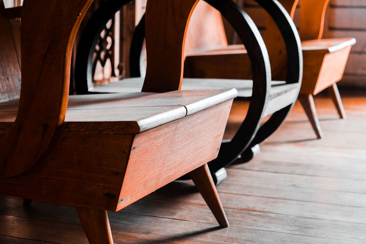 Empty wooden chairs in store