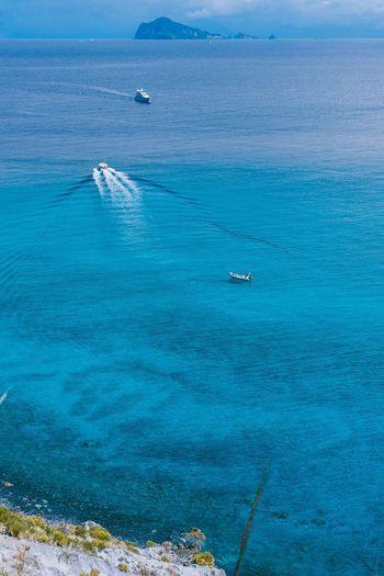 Isola Lipari Sea Boat Blue Beauty In Nature Seascape Nature Tranquility Lipari Sicilia Sicily Italy Italia Isole Eolie Isoleeolie First Eyeem Photo