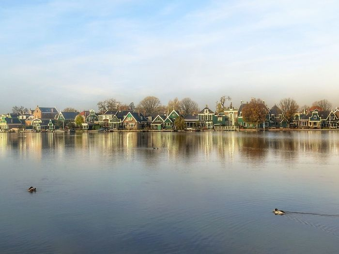 Zaanse Schans, Holland Architecture Beauty In Nature Bird Built Structure City Cloud Cloud - Sky Day Holland Houses And Homes Lake Nature No People Outdoors Reflection Rippled Scenics Sky Tourism Tourist Attraction  Tranquil Scene Tranquility Water Waterfront Zaanse Schans Postcards