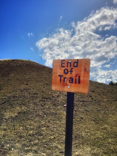 End Of Trail Fossil Beds EyeEm Exploring Oregon Scenery End Of Trail Communication Sky Text Cloud - Sky Day Nature Sign Western Script Sunlight Land Outdoors Blue Warning Sign Information Information Sign Capital Letter Guidance No People Road Sign