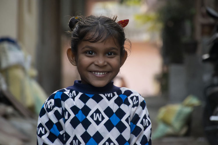 Portrait of happy indian young girl