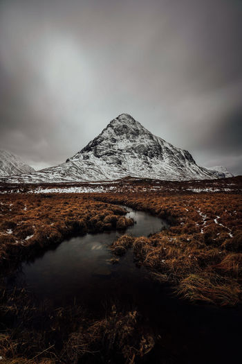 Mountains in rannoch moor in scotland scenic viev with lake and dark cloudy mood sky