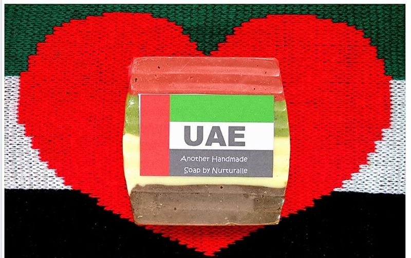 A bar of handmade soap I made with the national colors of the United Arab Emirates. Handmade Soaps And Candles Made In The UAE National Colours United Arab Emirates Bar Of Soap Close-up Communication Day Green Color Handmade Soap Heart Heart Shape Indoors  National Colors No People Red Text