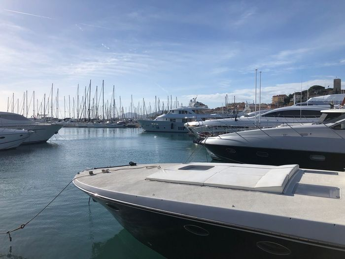 Nautical Vessel Transportation Mode Of Transportation Water Moored Sky Harbor Cloud - Sky Nature Sea Day No People Yacht Sailboat Mast Pole Outdoors Travel Reflection Marina Luxury Anchored