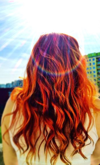 Rear View Of Redhead Girl Against Cloudy Sky