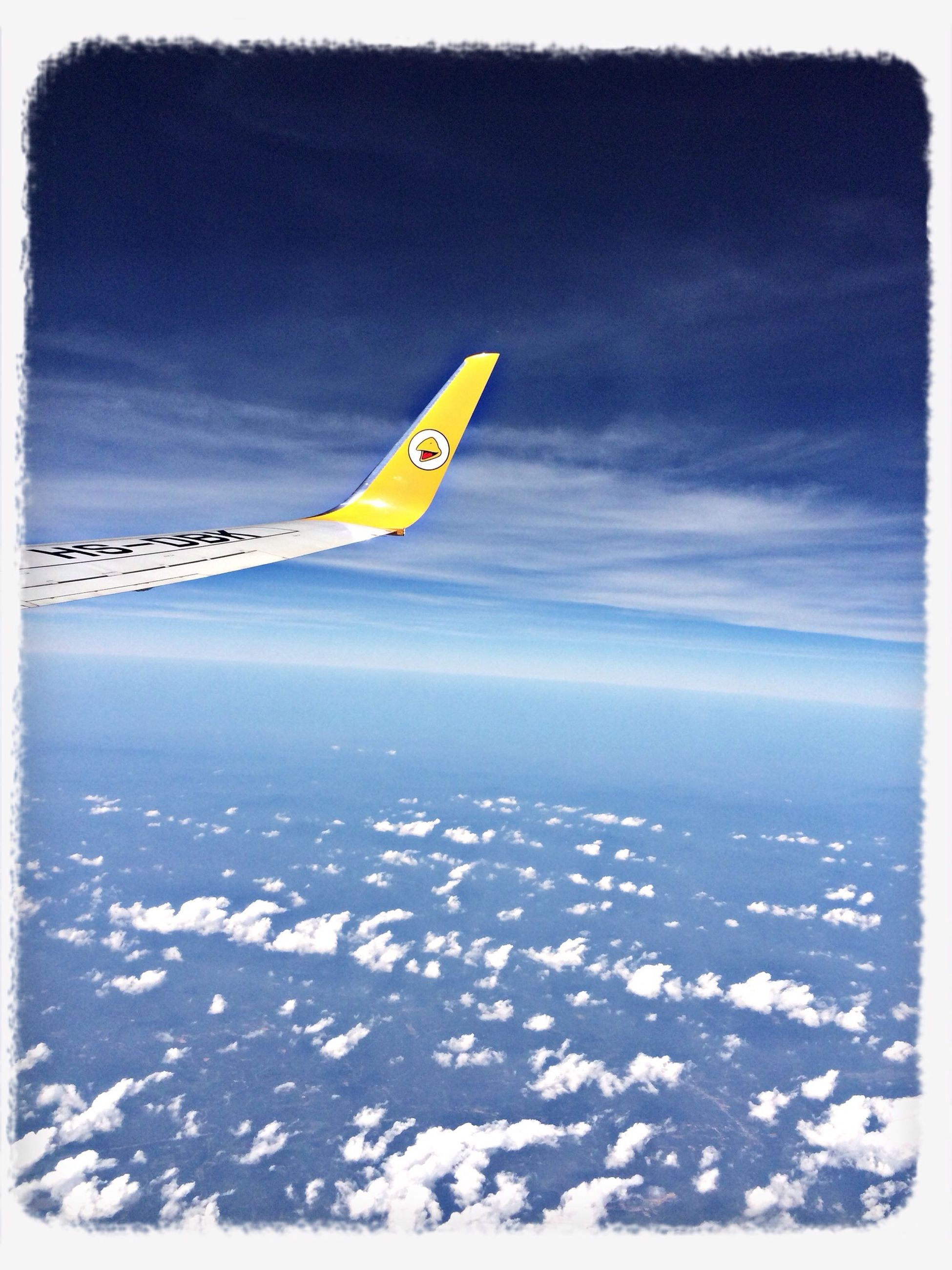 flying, transportation, transfer print, air vehicle, airplane, mode of transport, mid-air, sky, aircraft wing, scenics, aerial view, beauty in nature, auto post production filter, travel, nature, landscape, tranquil scene, journey, cloud - sky, tranquility
