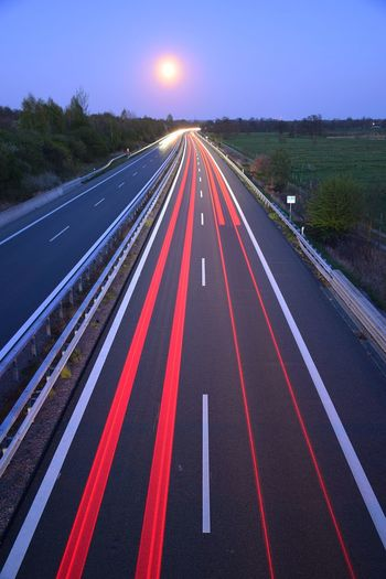Lighting Day Red Color Red Full Moon 🌕 Astronomy Road Multi Colored Astrology Sign Sky vanishing point Light Trail Treelined Tail Light Vehicle Light The Way Forward Highway Double Yellow Line Diminishing Perspective Road Marking Long Exposure