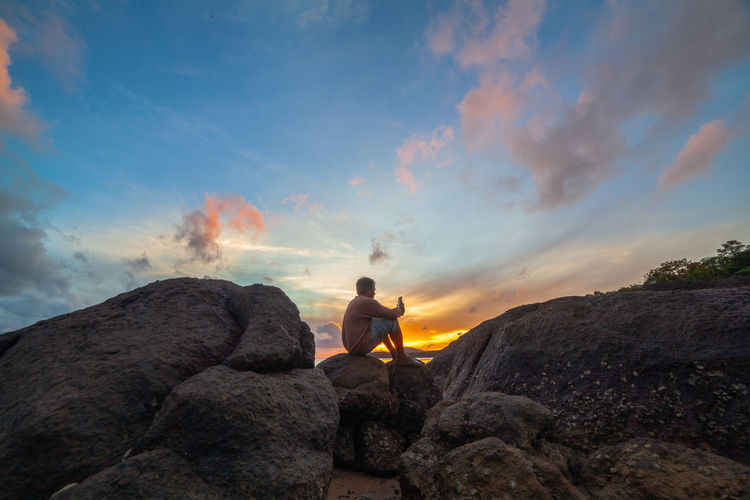 sunrise above the sea one man selfie on the rock Sky One Person Leisure Activity Beauty In Nature Cloud - Sky Nature Lifestyles Tranquility Sunset Scenics - Nature Man, People, Sunrise, Selfie, Mobile, Al Mardi Gras Phone,