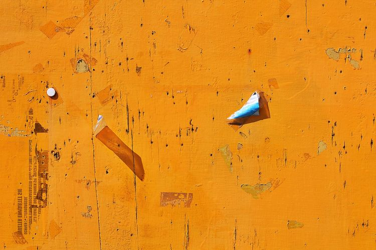 Full Frame Shot Of Yellow Wooden Wall On Sunny Day